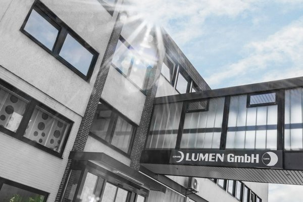 Company building of LUMEN GmbH under a blue sky